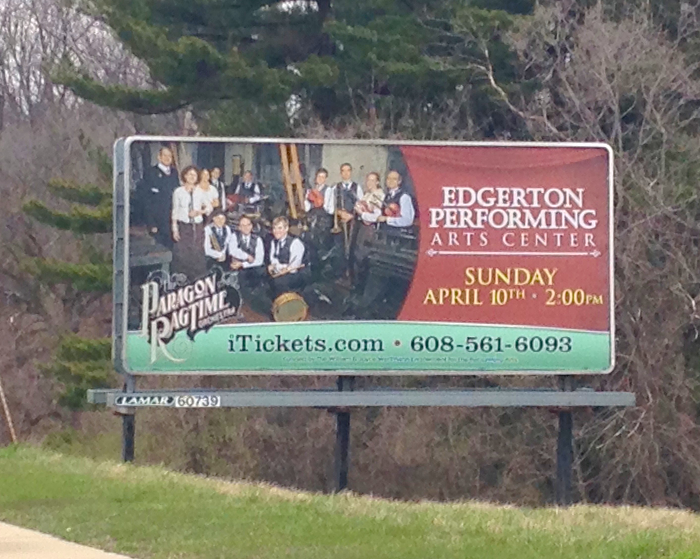 A roadside billboard for a PRO concert in Wisconsin